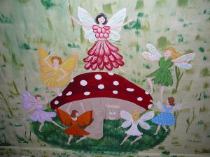 Fairies dancing around a mushroom